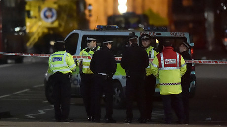 Police officers work at the scene after an attack on Westminster Bridge in London, Britain, March 22, 2017 © Hannah McKay