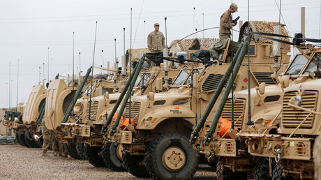 U.S. soldiers gather near military vehicles at an army base in Karamless town, east of Mosul © Ammar Awad
