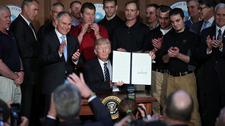 Investors, top businesses urge Trump to stay in Paris climate deal on eve of decision