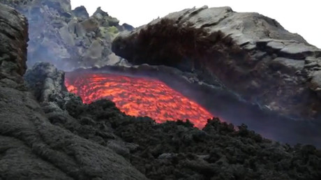 Rivers of hot lava flow onto slopes of Mount Etna after eruption (VIDEO)