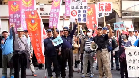 Protesters clash with police at rally against pension reforms in Taiwan