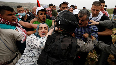 Palestinian protesters marking Land Day scuffle with Israeli security forces