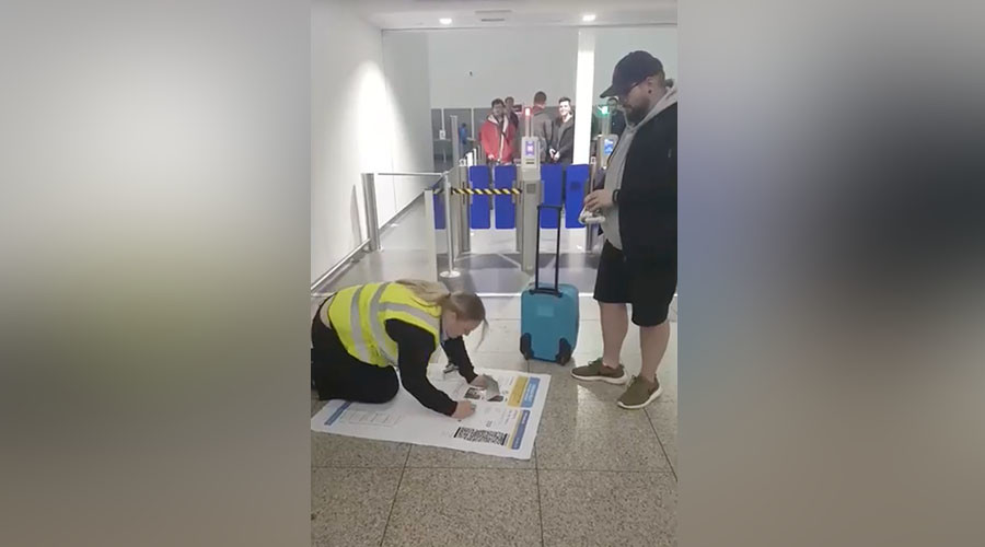 Practical joker tries to get on flight with massive boarding pass (VIDEO)