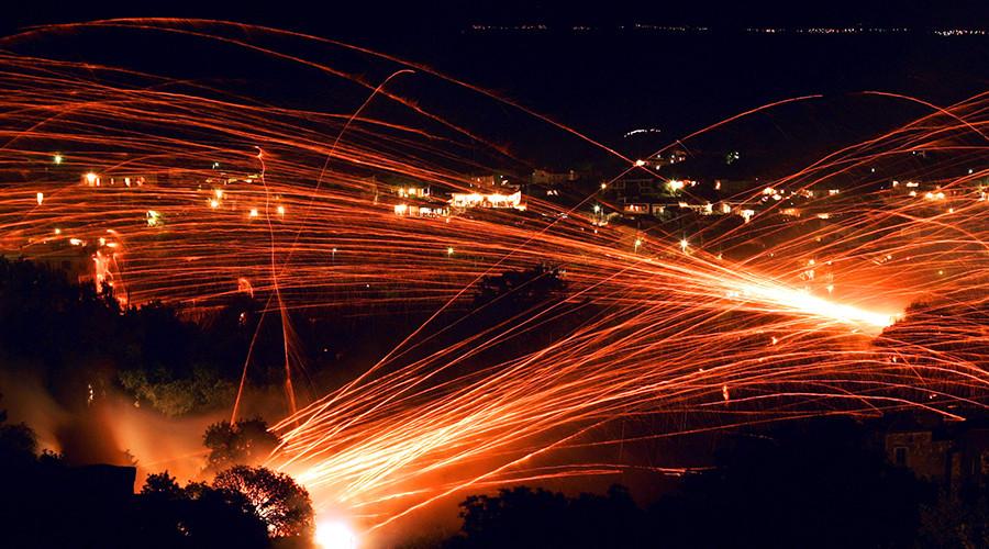 'Rocket War' returns to sleepy Greek island as thousands of fireworks light up night sky (VIDEO)