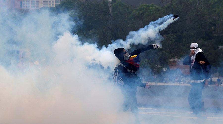 Violent scenes erupt on streets as Venezuelans stage massive anti-Maduro march (VIDEOS, PHOTOS)