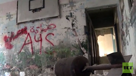 Munitions class: RT visits Aleppo school used by militants as weapons storage & factory