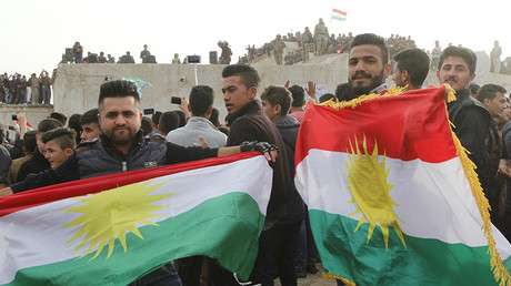 Kurdish residents hold flags during Norouz celebrations in Kirkuk, north of Baghdad. © Ako Rasheed