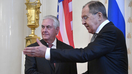 Russian Foreign Minister Sergey Lavrov (R) welcomes US Secretary of State Rex Tillerson before a meeting in Moscow on April 12, 2017. ©Alexander Nemenov