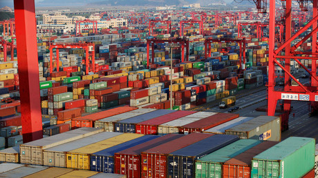 Container boxes are seen at the Yangshan Deep Water Port © Aly Song
