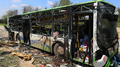 A damaged bus is seen after an explosion yesterday at insurgent-held al-Rashideen © Ammar Abdullah
