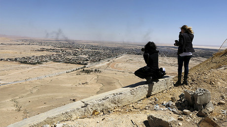 FILE PHOTO: Journalists take pictures of the modern city of Palmyra, Syria. © Omar Sanadiki