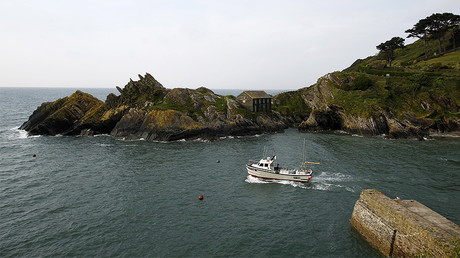 FILE PHOTO: A fishing boat makes its way from the port village of Polperro, Cornwall © Chris Helgren