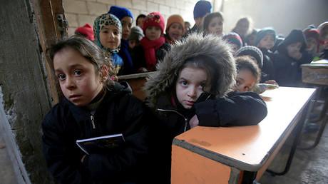 Children attend a classroom in Aleppo, Syria. ©Ali Hashisho