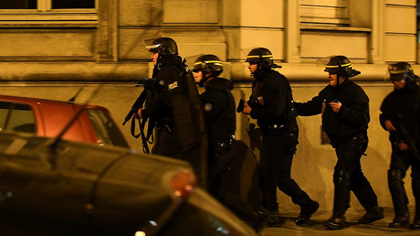 Police officers patrol near the site of a shooting at the Champs Elysees in Paris on April 20, 2017. © Franck Fife