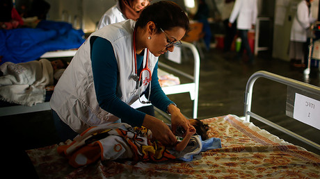 FILE PHOTO: A doctor checks an Iraqi girl at a hospital in Qayyara, Iraq. © Suhaib Salem