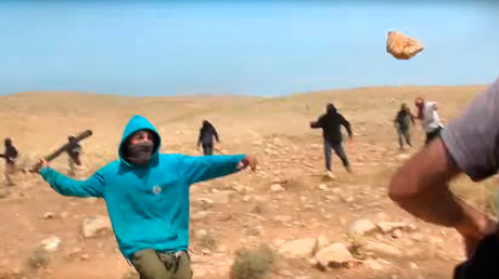 Israeli settlers attack activists and Palestinian shepherds © guybo111