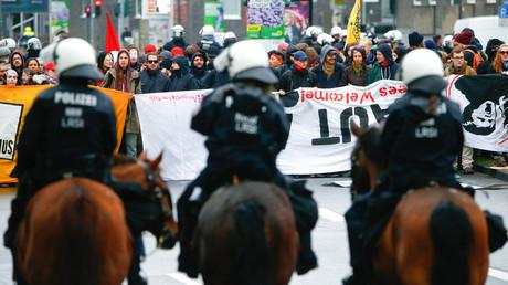 Mounted Police observe activists, Cologne, Germany, April 22, 2017. © Thilo Schmuelgen