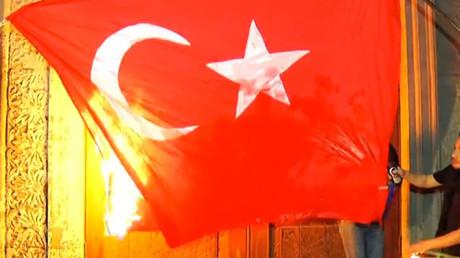 Turkish flag set ablaze as tens of thousands commemorate Armenian Genocide