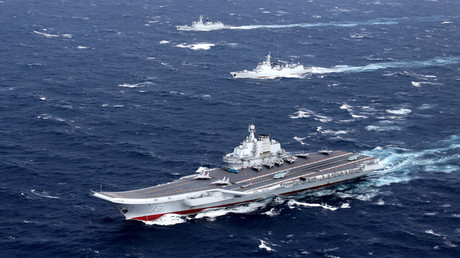 FILE PHOTO: China's Liaoning aircraft carrier conducts a drill in an area of South China Sea © Reuters