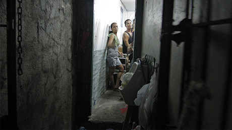 'People begging for water': Secret cell behind bookshelf exposed at Philippines police station
