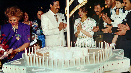 Saddam Hussein celebrates his birthday. An undated photo from the private archive of an official photographer for the regime © Reuters