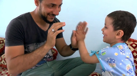 4-yo survivor of US-led coalition airstrike still has shrapnel in her legs & face (VIDEO)