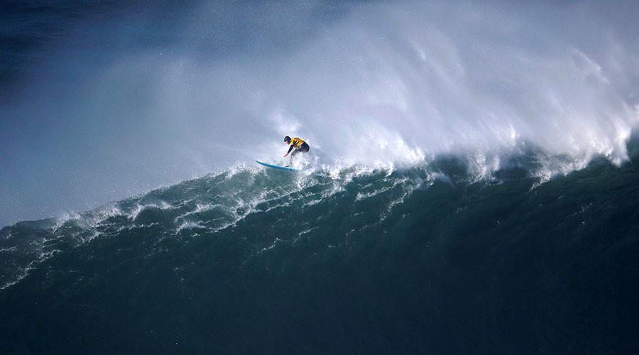Surfer missing for 32 hours found floating off another country's coast (VIDEO)