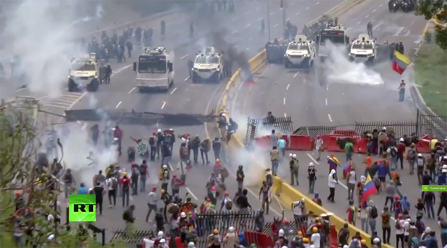 Police fire water cannon at anti-govt rally in Venezuela after pelted with smoke bombs