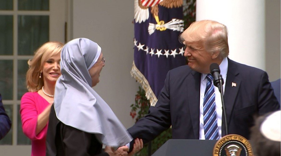 Bully pulpit: Trump signs order allowing political speech in church, lawsuit threatened