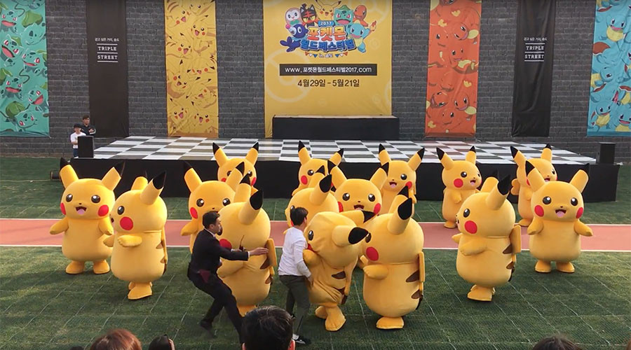 Rapidly Deflating Pikachu Rushed To Safety By Small Horde Of Suited Men