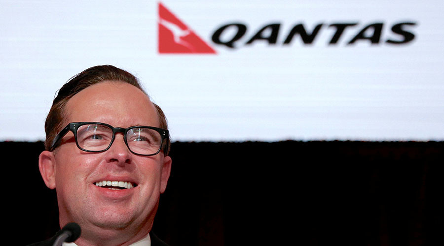 Qantas CEO gets smashed in face with massive cream pie (VIDEO)
