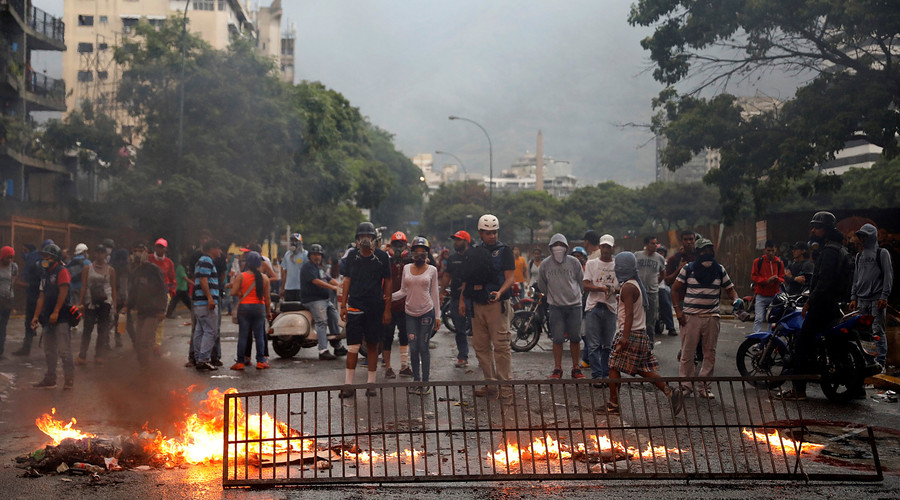 Elderly Venezuelans clash with police in opposition march