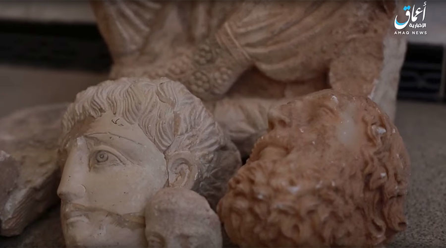 ISIS destroys ancient artefacts as campaign against Syrian heritage sites continues (VIDEO)