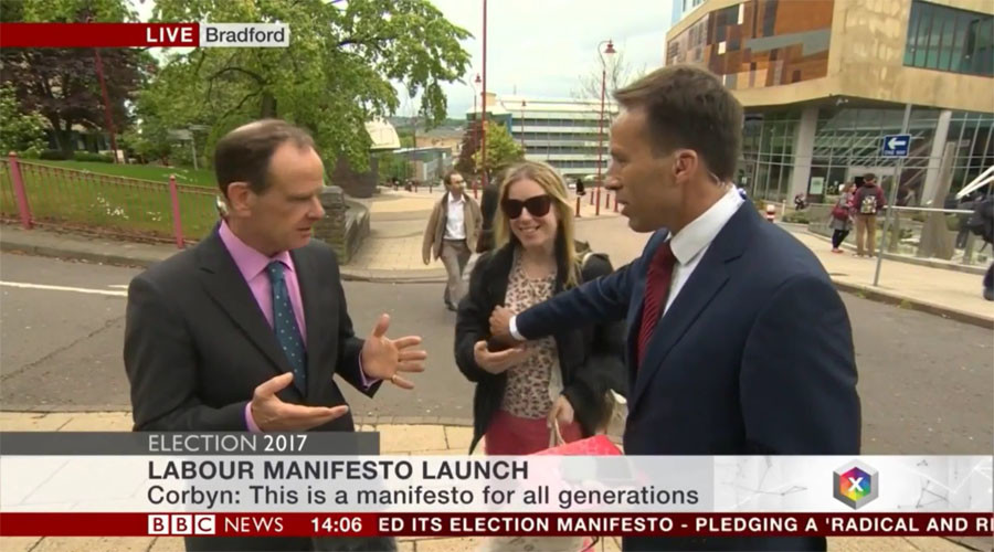 BBC reporter slapped after accidentally groping woman who interrupted live interview