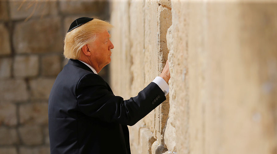 In 1st for US presidents, Trump prays at Western Wall in Jerusalem
