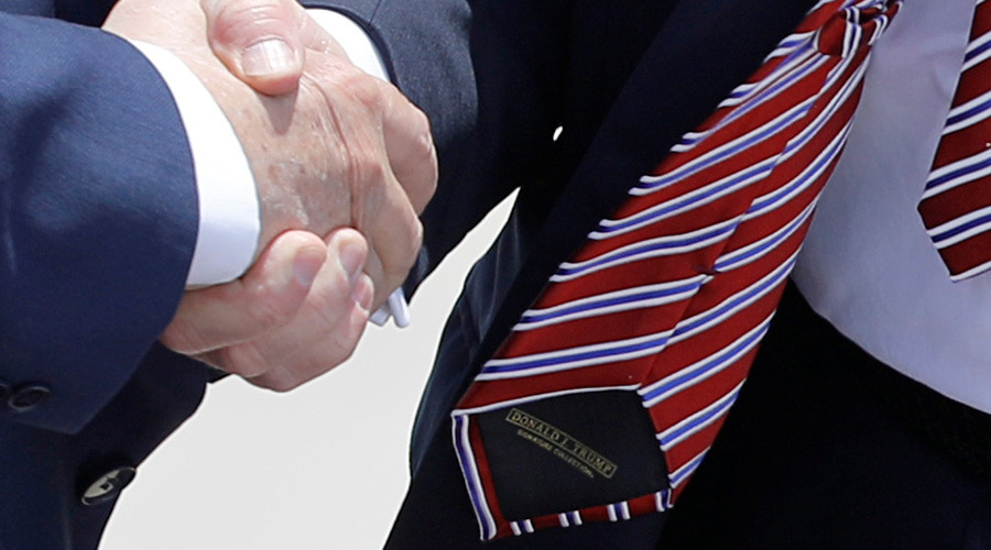 Trump gets beaten at his own never-ending handshake game