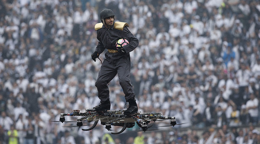 Man on drone delivers soccer ball to stadium in dramatic stunt (VIDEO)