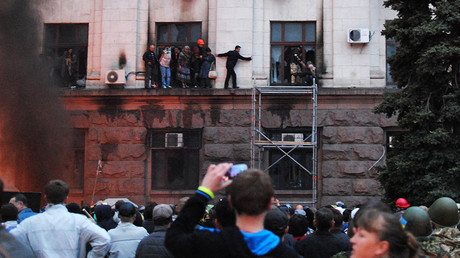 People climbing out on the moulding of Odessa's Trade Unions House during the fire May 2, 2014. © Aleksandr Polischyuk