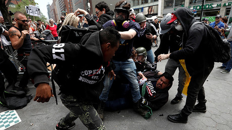 Demonstrators clash with people opposing their rally during a May Day protest, New York City, U.S. May 1, 2017. © Mike Segar