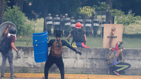 Protesters confront police after breaking a fence surrounding an air force base,Caracas, Venezuela May 1, 2017. © Carlos Garcia Rawlins