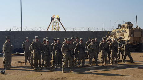 U.S. soldiers gather at a military base north of Mosul, Iraq © Stephen Kalin