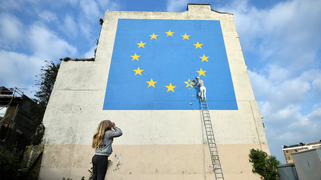 A girl looks at artwork attributed to street artist Banksy, Dover, Britain, May 7, 2017. © Hannah McKay