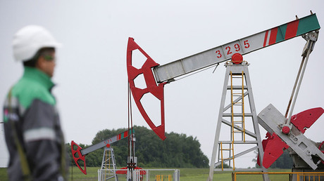 A worker looks at a pump jack at an oil field in Bashkortostan, Russia ©Sergei Karpukhin