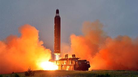 FILE PHOTO: A test launch of ground-to-ground medium long-range ballistic rocket Hwasong-10 © KCNA