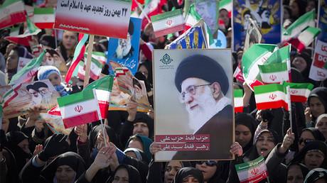 FILE PHOTO: Demonstrators wave the Iranian flag and hold a picture of Supreme Leader Ayatollah Ali Khamenei © Caren Firouz