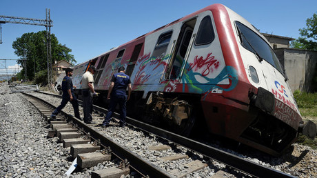 Derailed train plunges into house in Greece
