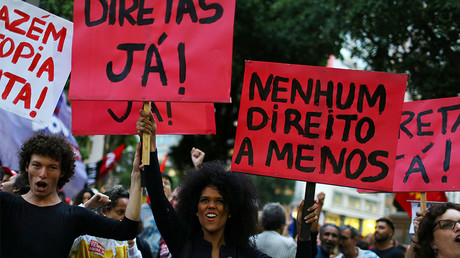 A protest against Brazil's President Michel Temer. The signs read: