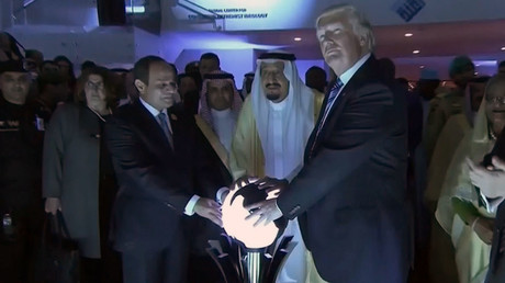 U.S. President Donald Trump places his hands on a glowing orb as he tours with other leaders the Global Center for Combatting Extremist Ideology in Riyadh, Saudi Arabia May 21, 2017. © Saudi TV