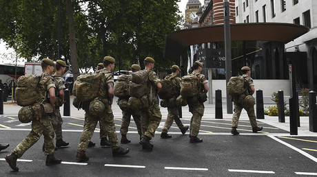 British soldiers arrive by bus and head toward a building next to New Scotland Yard police headquarters near to the Houses of Parliament in central London on May 24, 2017. ©AFP
