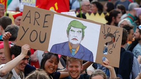 'Trump not Welcome': Thousands protest US President's visit ahead of NATO summit in Brussels
